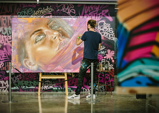 Artist Adnate doing a live painting for LCI Melbourne auction